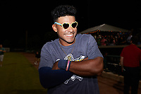 Charleston RiverDogs center fielder Garrett Hiott (8) poses for a photo wearing a pair of heart-shaped glasses following the win over the Down East Wood Ducks in the 2021 Low-A East Championship at Joseph P. Riley, Jr. Park on September 26, 2021 in Charleston, South Carolina. (Brian Westerholt/Four Seam Images)