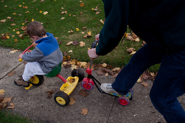 My older son, age three, and my husband play outside together.