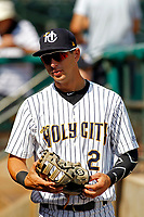 """Charleston Riverdogs infielder Chris Hess (2) before a game against the Hickory Crawdads at the Joseph P. Riley For Sunday games, the Riverdogs wear their """"Holy City"""" uniforms in honor of the city's nickname. Hickory defeated Charleston 8-7. (Robert Gurganus/Four Seam Images)"""