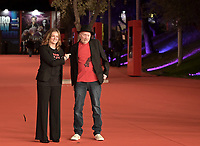 """Director Silenn Thomas (L) and US comic book writer Frank Miller (R) pose on the red carpet for the movie """"American Genius"""" at the 16th edition of the Rome Film Fest in Rome, on October 22, 2021.<br /> UPDATE IMAGES PRESS/Isabella Bonotto"""