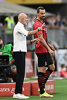 Stefano Pioli coach of AC Milan and Zlatan Ibrahimovic during the Serie A 2021/2022 football match between AC Milan and SS Lazio at Giuseppe Meazza stadium in Milano (Italy), August 29th, 2021. Photo Image Sport / Insidefoto