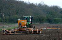 Photo: Richard Lane/Richard Lane Photography..A John Deere 8420T tractor pulls a Simba Free Flow 6 metre seed drill, sowing spring barley in a field in the Chiltern Hills near Beaconsfield, South Buckinghamshire. 09/04/2004.