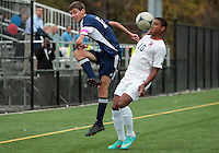 HYATTSVILLE, MD - OCTOBER 26, 2012:  Sean Cowdrey (10) of DeMatha Catholic High School backs into Nate Johnson (19) of St. Albans during a match at Heurich Field in Hyattsville, MD. on October 26. DeMatha won 2-0.