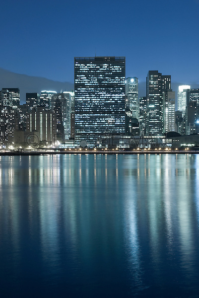 AVAILABLE FROM JEFF AS A FINE ART PRINT.<br /> <br /> AVAILABLE FROM JEFF FOR COMMERCIAL AND EDITORIAL LICENSING.<br /> <br /> United Nations Headquarters and East River at Night, Midtown Manhattan, New York City, New York State, USA