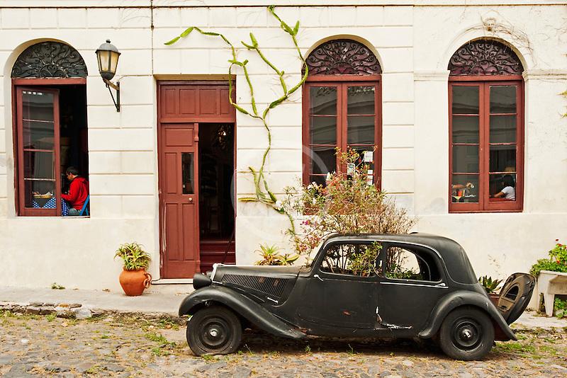 Uruguay, Colonia de Sacramento, Abandoned antique automobile on cobbled street