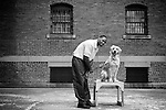 """.KAREEM AND 18-MONTH-OLD GOLDEN RETRIEVER,TUCKET --  Kareem is in prison for 13 years and has served 10 years.  KAREEM: """"I committed numerous armed robberies and attempted murder. Prior to raising my pup my life has always been all about me, meaning, I never carried the responsibility of another person. Having a pup made me situate my life around him as opposed to me putting myself first. I'm training Tucket to be a service dog for a disabled person. He is very good with his commands, he loves to work which his strength. The hardest part of this program is bonding and nurturing a wonderful companion and know that we will have to separate when his training is up. """"..The Puppies Behind Bars (PPB) Program works with prison inmates in New York, New Jersey, and Connecticut to train service dogs, including ones who help injured soldiers. The puppies arrive at 8 weeks-old and remain at the prisons, mostly working with one inmate, for 20 months. Fishkill Correctional Facility is a medium security prison in New York with 22 men in the puppy program. The emotional element of caring for the puppies breaks down the hard façade that most prisoners create for themselves to survive prison life.  Prisoners learn responsibility and pride in helping others. The program often gives them a new outlook on their crimes, their time in prison, and goals when they are released. ."""
