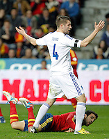 Spain's Cesc Fabregas (d) and Finland's Toivio during international match of the qualifiers for the FIFA World Cup Brazil 2014.March 22,2013.(ALTERPHOTOS/Victor Blanco)