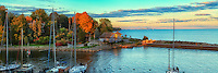 A fall evening sunset view of the Oakville harbour with the Toronto skyline in the background.