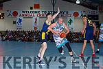 Kieran Donaghy Tralee Warriors powers past Darragh Jones Keanes Supervalu Killorglin during the Premier Mens final at St Marys Christmas Bastketball blitz on Monday night