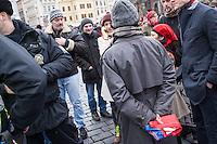 """Am 31. Januar 2015 protestierten auf dem Staromestske Namesti-Platz (Alststaetter Markt / Old Town Square) in Prag Vertreter verschiedener Religionen, Antifaschisten, Sinti und Roma mit einem Gottesdienst, Gesaengen gegen eine Kundgebung von ca. 500 Prager Pegida-Anhaengern. Auf Plakaten und Schildern wurde sich zum Teil ueber die Islamophobie der Pegida-Anhaenger lustig gemacht. Beide Veranstaltungen fanden gleichzeitig nebeneinander auf dem Platz  statt. Aus der Pegida-Kundgebung kamen immer wieder heftige Beschimpfungen und Neonazis versuchten Gegendemonstranten ein Transparent zu entreissen.<br /> Wie in Deutschland bestehen die Pegida auch in Prag aus Neonazis, Hooligans, Islamsfeinde und sog. """"Besorgten Buergern"""".<br /> Im Bild: Die Polizei will nach Anzeige durch Pegida-Anhaenger den evangelischen Pfarrer Mikulas Vymetal festnehmen, da er eine Tschechische Nationalflagge mit dem Symbol der Roma getragen hat. Das gilt als Verunglimpfung des Staates.<br /> 31.1.2015, Prag<br /> [Inhaltsveraendernde Manipulation des Fotos nur nach ausdruecklicher Genehmigung des Fotografen. Vereinbarungen ueber Abtretung von Persoenlichkeitsrechten/Model Release der abgebildeten Person/Personen liegen nicht vor. NO MODEL RELEASE! Nur fuer Redaktionelle Zwecke. Don't publish without copyright Christian-Ditsch.de, Veroeffentlichung nur mit Fotografennennung, sowie gegen Honorar, MwSt. und Beleg. Konto: I N G - D i B a, IBAN DE58500105175400192269, BIC INGDDEFFXXX, Kontakt: post@christian-ditsch.de<br /> Bei der Bearbeitung der Dateiinformationen darf die Urheberkennzeichnung in den EXIF- und  IPTC-Daten nicht entfernt werden, diese sind in digitalen Medien nach §95c UrhG rechtlich geschuetzt. Der Urhebervermerk wird gemaess §13 UrhG verlangt.]"""