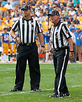 ACC football officials pictured are umpire Mike Morton (left) and center judge Mike Webster. The Pitt Panthers defeated the Syracuse Orange 44-37 in overtime at Heinz Field in Pittsburgh, Pennsylvania on October 6, 2018.