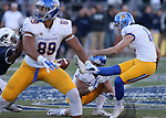 Nevada's Ahki Muhammad (3), left, blocks a field goal attempt by San Jose State's Austin Lopez (12) during an NCAA college football game in Reno, Nev., on Saturday, Nov. 14, 2015. San Jose State's Josh Oliver (89) and Chris Kearney (11) were in on the play. Nevada won 37-34 in overtime. (AP Photo/Cathleen Allison)