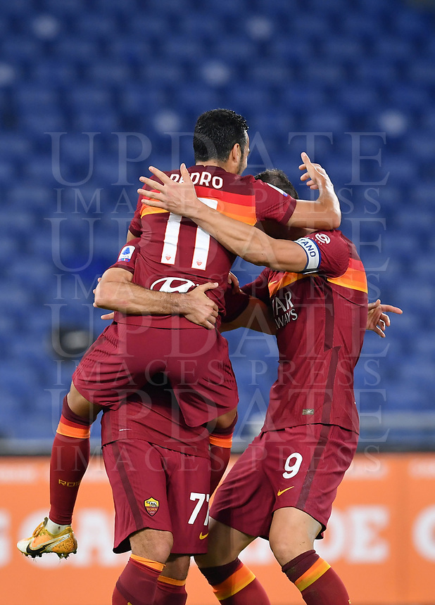 Football, Serie A: AS Roma - Fiorentina, Olympic stadium, Rome, November 1, 2020. <br /> Roma's Pedro Rodriguez (l) celebrates after scoring with his teammates Henrich Mkhitaryan (c) and captain Edin Dzeko (r) during the Italian Serie A football match between Roma and Fiorentina at Olympic stadium in Rome, on November 1, 2020. <br /> UPDATE IMAGES PRESS/Isabella Bonotto