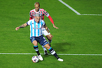 20th July 2021; Buenos Aires, Argentina;  Enzo Copetti do Racing challenges Miranda of São Paulo, during the match between Racing and São Paulo, for the Libertadores 2021 Final Round, at Estádio Presidente Perón this Tuesday 20th.