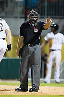 Home plate umpire Derek Mollica points into the Gwinnett Braves dugout to warn them to stop complaining about balls and strikes during the game against the Charlotte Knights at BB&T Ballpark on August 19, 2014 in Charlotte, North Carolina.  The Braves defeated the Knights 10-5.   (Brian Westerholt/Four Seam Images)