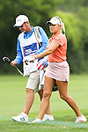 USA Natalie Gulbis (right) and her caddie (left) walk down the 4th fairway at the LPGA Championship 2011 Sponsored By Wegmans at Locust Hill Country Club in Rochester, New York on June 25, 2011