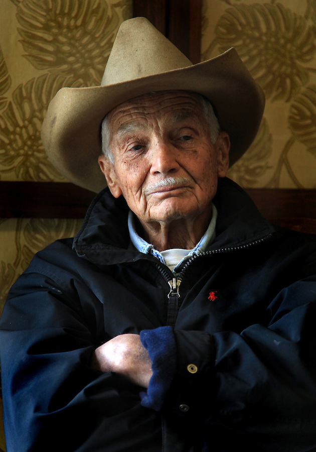 "Retired Parker Ranch manager and cowboy, Jamie Dowsett, 85, who spent most of his life on horses and has rich stories to tell, is photographed wearing his favorite cowboy hat at his home in Waimea, Hi.  ""I'm 85 years old and I still think that cows and horses are the best things that ever walked on earth.  I would give anything if I could still be a cowboy...being out there on the land where nobody bothers you, out in the open where it's quiet...the horses are giving you a wonderful ride in the beautiful countryside...that is a feeling not many people have the opportunity to experience,"" says Dowsett wistfully."