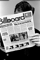 Montreal, CANADA - File Photo -  Manager Nick Carbone read BILLBOARD in his office, March 1988<br /> Photo : Agence Quebec Presse  - Pierre Roussel