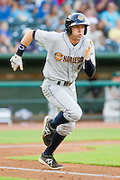 Jake Cave (6) of the Charleston RiverDogs hustles down the first base line against the Greensboro Grasshoppers at NewBridge Bank Park on July 17, 2013 in Greensboro, North Carolina.  The Grasshoppers defeated the RiverDogs 4-3.  (Brian Westerholt/Four Seam Images)