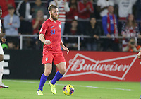 ORLANDO, FL - NOVEMBER 15: Tim Ream #13 of the Unites States dribbles with the ball during a game between Canada and USMNT at Exploria Stadium on November 15, 2019 in Orlando, Florida.