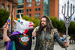 """© Joel Goodman - 07973 332324. 30/07/2017 . Manchester , UK . """" The Gay Unicorn """" (Joseph Jones, 18 from West Yorkshire) with New Aquaman (Robin Yardley (31 from Worcestershire) . Cosplayers, families and guests at Comic Con at the Manchester Central Convention Centre . Photo credit : Joel Goodman"""