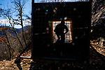Balkan Lynx (Lynx lynx balcanicus) biologist, Eko Veapi, testing box trap, Mavrovo National Park, North Macedonia