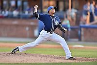 Asheville Tourists pitcher Cristian Quintin (30) delivers a pitch during a game against the Hagerstown Suns at McCormick Field on April 28, 2016 in Asheville, North Carolina. The Tourists were leading the Suns 6-5 when the game was delayed in the top of the 6th inning due to darkness. (Tony Farlow/Four Seam Images)