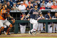 Arizona Wildcats catcher Cesar Salazar (12) follows through on his swing against the Oklahoma State Cowboys in Game 6 of the NCAA College World Series on June 20, 2016 at TD Ameritrade Park in Omaha, Nebraska. Oklahoma State defeated Arizona 1-0. (Andrew Woolley/Four Seam Images)