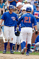 August 9, 2009:  Outfielder Brad Snyder of the Iowa Cubs greets John-Ford Griffin after hitting a home run during a game at Wrigley Field in Chicago, IL.  Iowa is the Pacific Coast League Triple-A affiliate of the Chicago Cubs.  Photo By Mike Janes/Four Seam Images