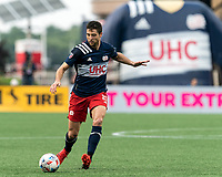 FOXBOROUGH, MA - AUGUST 8: Matt Polster #8 of New England Revolution passes the ball during a game between Philadelphia Union and New England Revolution at Gillette Stadium on August 8, 2021 in Foxborough, Massachusetts.