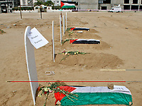 "A fake cemetery to represent the diminishing number of factories in Gaza, during a protest calling for an end of the Israeli siege to the Gaza Strip March 18, 2008.""photo by Fady Adwan"""