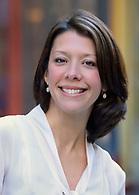 Outdoor headshot of a female executive.
