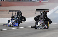 Nov. 1, 2008; Las Vegas, NV, USA: NHRA top fuel dragster drivers Hillary Will (right) and Antron Brown during qualifying for the Las Vegas Nationals at The Strip in Las Vegas. Mandatory Credit: Mark J. Rebilas-