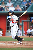 Andres Sotillo (16) of the Lansing Lugnuts follows through on his swing against the South Bend Cubs at Cooley Law School Stadium on June 15, 2018 in Lansing, Michigan. The Lugnuts defeated the Cubs 6-4.  (Brian Westerholt/Four Seam Images)