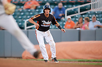 Aberdeen IronBirds catcher Alfredo Gonzalez (19) leads off first base during a game against the Staten Island Yankees on August 23, 2018 at Leidos Field at Ripken Stadium in Aberdeen, Maryland.  Aberdeen defeated Staten Island 6-2.  (Mike Janes/Four Seam Images)