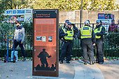 Permanent display board, and police on stand-by.  Speakers' Corner, Hyde Park, London.