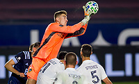 CARSON, CA - OCTOBER 18: Jonathan Klinsmann #33 GK of Los Angeles Galaxy leaps high for a ball and save during a game between Vancouver Whitecaps and Los Angeles Galaxy at Dignity Heath Sports Park on October 18, 2020 in Carson, California.