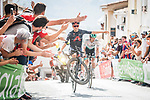 Tom Pidcock (GBR) Ineos Grenadiers entertains the crowds on the final slope during Stage 11 of La Vuelta d'Espana 2021, running 133.6km from Antequera to Valdepeñas de Jaén, Spain. 25th August 2021.      <br /> Picture: Unipublic/Charly Lopez | Cyclefile<br /> <br /> All photos usage must carry mandatory copyright credit (© Cyclefile | Charly Lopez/Unipublic)