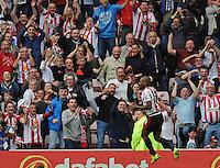 Jermain Defoe of Sunderland celebrates scoring their first goalduring the Barclays Premier League match between Sunderland and Swansea City played at Stadium of Light, Sunderland