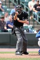 May 2, 2010:  Home plate umpire Vic Carapazza makes a call during a game at Frontier Field in Rochester, NY.  Photo By Mike Janes/Four Seam Images