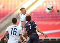 ZAPOPAN, MEXICO - MARCH 21: Justen Glad #4 of the United States heads the ball towards goal during a game between Dominican Republic and USMNT U-23 at Estadio Akron on March 21, 2021 in Zapopan, Mexico.