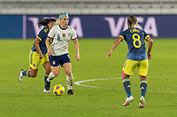 ORLANDO, FL - JANUARY 22: Julie Ertz #8 dribbles the ball while defended by Jéssica Caro #8 during a game between Colombia and USWNT at Exploria stadium on January 22, 2021 in Orlando, Florida.