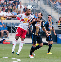 Jeff Parke (31) of the Philadelphia Union goes up for a header with Thierry Henry (14) of the New York Red Bulls during a Major League Soccer game at PPL Park in Chester, PA.  Philadelphia defeated New York, 3-0.