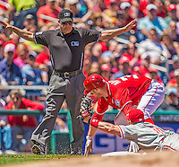 26 May 2013: MLB Umpire Tim Timmons calls Washington Nationals outfielder Bryce Harper safe at third during a game against the Philadelphia Phillies at Nationals Park in Washington, DC. The Nationals defeated the Phillies 6-1, taking the rubber game of their 3-game weekend series. Mandatory Credit: Ed Wolfstein Photo *** RAW (NEF) Image File Available ***
