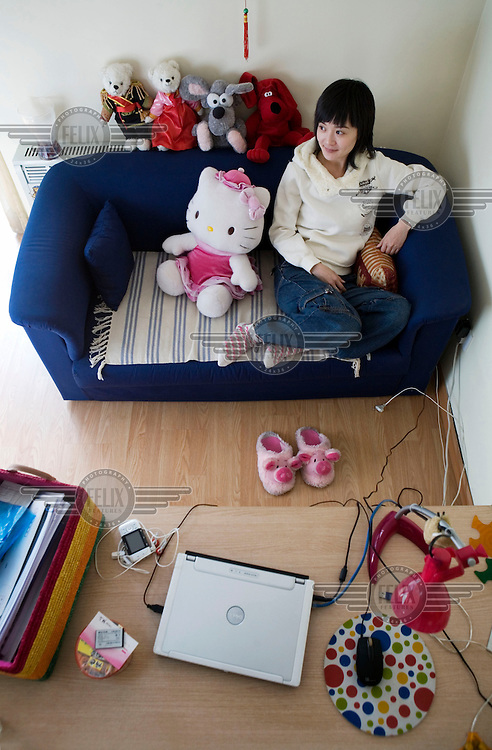 Vicky, a 30 year old actuary at an international accounting firm, at her home in Beijing.