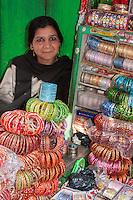 Nepal, Patan.  Muslim Nepali Woman Selling Plastic Bracelets.
