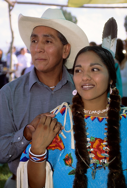Native American family of Shoshone Bannock cowboy father with traditionally dressed daughter during an honoring ceremony on the Fort Hall Indian Reservation, Idaho.