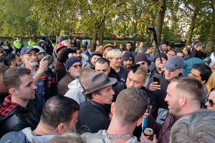 Veteran Marxist speaker Heiko Khoo argues with Tommy Robinson supporters, Speakers' Corner, Hyde Park, London.