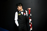CHINA. Beijing. Chinese snooker player Liang Wenbo backstage just before going to play at the China Snooker Open. Snooker is a cue sport played on a large table measuring 3.6 metres x 1.8 metres. Originating in India in the late 19th Century where it was invented by British Army officers, the game has been a mainstay in British sport over the past few decades. Recently however, popularity of the sport has declined as the sport struggles to compete with other popular sports. The sport is however flourishing in countries such as China, where it is now the second most popular sport, behind Basketball. In a country where the  players are treated like movie-stars, China may be the great hope for the sports recovery. 2009