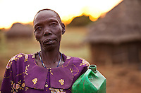 A woman holding a jerry can for water in Madi Opei, Uganda. the area is populated with people displaced by the decades long conflict with the Ugandan rebel group the  Lord's resitance Army.